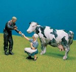 1-35-Would-you-like-some-milk-w-milking-cow